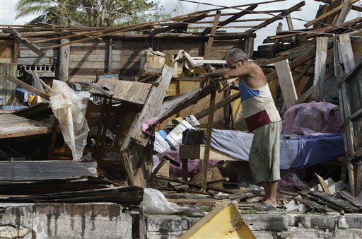 Resident Antonio Garces tries to recover his belongings from his house destroyed by Hurricane Sandy in Aguacate, Cuba, Thursday Oct. 25, 2012. Hurricane Sandy blasted across eastern Cuba on Thursday as a potent Category 2 storm and headed for the Bahamas after causing at least two deaths in the Caribbean. &#40;AP Photo&#47;Franklin Reyes&#41; <span class=meta>(AP Photo&#47; Franklin Reyes)</span>