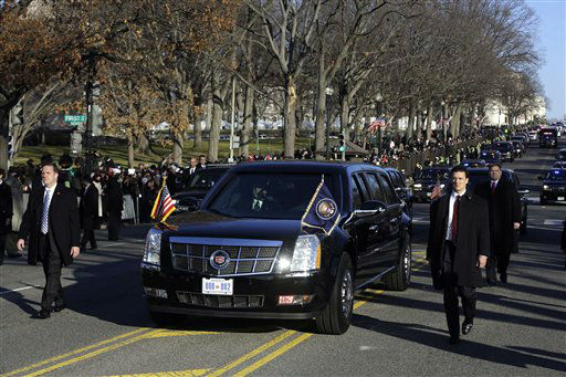 "<div class=""meta ""><span class=""caption-text "">President Barack Obama and first lady Michelle Obama ride in the presidential limousine during the 57th Presidential Inauguration parade Monday, Jan. 21, 2013, in Washington. (AP Photo/Charles Dharapak) (AP Photo/ Charles Dharapak)</span></div>"