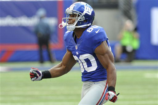 New York Giants wide receiver Victor Cruz &#40;80&#41; reacts after a play during the first half of an NFL football game against the Tampa Bay Buccaneers Sunday, Sept. 16, 2012, in East Rutherford, N.J. &#40;AP Photo&#47;Bill Kostroun&#41; <span class=meta>(AP Photo&#47; Bill Kostroun)</span>