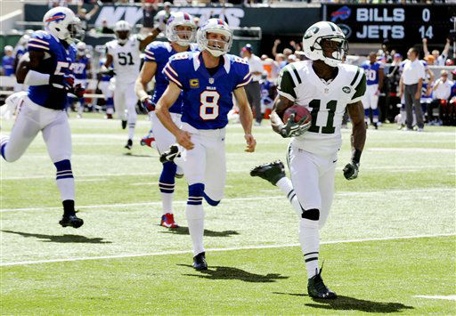 New York Jets wide receiver Jeremy Kerley &#40;11&#41; returns a punt for a touchdown past Buffalo Bills punter Brian Moorman &#40;8&#41; during the first half of an NFL football game, Sunday, Sept. 9, 2012, in East Rutherford, N.J. &#40;AP Photo&#47;Bill Kostroun&#41; <span class=meta>(AP Photo&#47; Bill Kostroun)</span>