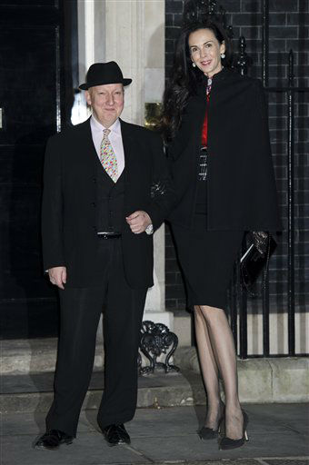 L&#39;Wren Scott and Stephen Jones arrive for the London Fashion Week reception party at 10 Downing Street, Friday, Feb. 15, 2013, London. &#40;Photo by Jonathan Short&#47;Invision&#47;AP&#41; <span class=meta>(Photo&#47;Jonathan Short)</span>