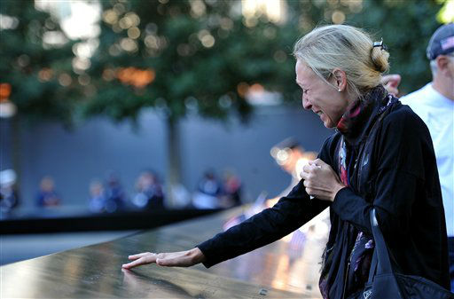 "<div class=""meta image-caption""><div class=""origin-logo origin-image ""><span></span></div><span class=""caption-text"">Alicia Watkins remembers a friend who died at the Pentagon during a ceremony marking the 11th anniversary of the Sept. 11 attacks at the National September 11 Memorial at the World Trade Center site in New York, Tuesday, Sept. 11, 2012. (AP Photo/The Daily News, Todd Maisel, Pool) (AP Photo/ Todd Maisel)</span></div>"