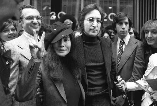 Former Beatle John Lennon and his wife, Yoko Ono, leave U.S. Immigration hearing in New York on April 18, 1972. Lennon was given 60 days to leave the country voluntarily or be deported as an undesirable alien at the hearings. Lennon is being deported as part of President Nixon&#39;s effort to silence him as a critic of the war in Vietnam.   &#40;AP Photo&#41; <span class=meta>(AP Photo&#47; XMB PC)</span>