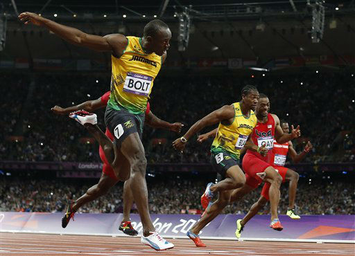 "<div class=""meta ""><span class=""caption-text "">Jamaica's Usain Bolt, foreground left, goes to cross the finish line ahead of Jamaica's Yohan Blake, third from right, United States' Tyson Gay, second from right, and Trinidad's Richard Thompson in the men's 100-meters final during the athletics in the Olympic Stadium at the 2012 Summer Olympics, London, Sunday, Aug. 5, 2012. (AP Photo/Matt Dunham) (AP Photo/ Matt Dunham)</span></div>"
