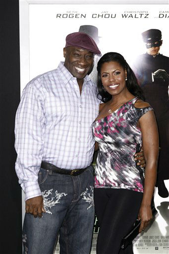 FILE - In this Monday, Jan 10, 2011 photo, Michael Clarke Duncan, left, and his fiancee Omarosa Manigault arrive at the premiere of &#34;The Green Hornet&#34; in Los Angeles. Duncan has died at the age of 54 on Monday, Sept. 3, 2012 in a Los Angeles hospital after nearly two months of treatment following a July 13, 2012 heart attack, Manigault said. &#40;AP Photo&#47;Matt Sayles&#41; <span class=meta>(AP Photo&#47; Matt Sayles)</span>