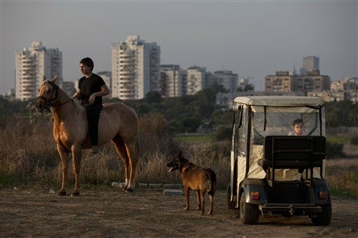 Israelis watch a military Iron Dome defense missile system, designed to intercept and destroy incoming short-range rockets and artillery shells from Gaza, in Tel Aviv Sunday, Nov. 18, 2012. &#40;AP Photo&#47;Oded Balilty&#41; <span class=meta>(AP Photo&#47; Oded Balilty)</span>