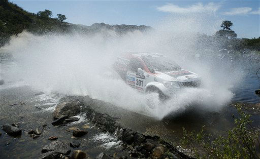Giniel de Villiers of South Africa and Dirk Von Zitzewitz of Germany race their Toyota across a river during the 10th stage of the 2013 Dakar Rally from Cordoba to La Rioja, Argentina, Tuesday, Jan. 15, 2013. The race finishes in Santiago, Chile, on Jan. 20. &#40;AP Photo&#47;Victor R. Caivano&#41; <span class=meta>(AP Photo&#47; Victor R. Caivano)</span>