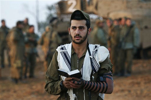 "<div class=""meta image-caption""><div class=""origin-logo origin-image ""><span></span></div><span class=""caption-text"">An Israeli soldier prays at a staging area near the Israel Gaza Strip Border, southern Israel, Tuesday, Nov. 20, 2012. On Tuesday, grieving Gazans were burying militants and civilians killed in ongoing Israeli airstrikes, and barrages of rockets from Gaza sent terrified Israelis scurrying to take cover. Efforts to end a week-old convulsion of Israeli-Palestinian violence drew in the world's top diplomats Tuesday, with U.S. President Barack Obama dispatching his secretary of state to the region on an emergency mission and the U.N. chief appealing from Cairo for an immediate cease-fire. (AP Photo/Lefteris Pitarakis)</span></div>"