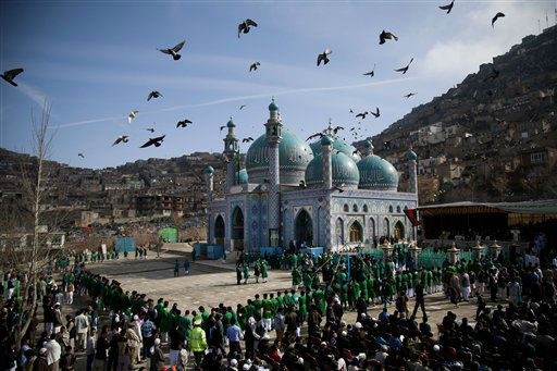 "<div class=""meta ""><span class=""caption-text "">Hundreds of Afghans wait to see the holy flag at the Kart-e Sakhi mosque in Kabul, Afghanistan, Thursday, March 21, 2013. Afghanistan celebrates Nowruz, marking the first day of spring and the beginning of the year on the Iranian calendar. (AP Photo/Anja Niedringhaus)</span></div>"