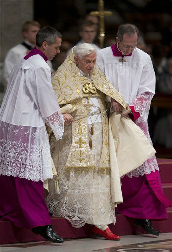 Pope Benedict XVI is helped walk down steps by his aides as he presides a New Year&#39;s Eve vespers service in St. Peter&#39;s Basilica at the Vatican, Monday, Dec. 31, 2012. Pope Benedict XVI has marked the end of a difficult year by saying that despite all the death and injustice in the world, goodness prevails. Benedict celebrated New Year&#39;s Eve with a vespers service in St. Peter&#39;s Basilica to give thanks for 2012 and look ahead to 2013. He looked tired during the service and used a cane afterward, an indication that the busy Christmas season may be taking a toll on the 85-year-old Benedict. &#40;AP Photo&#47;Andrew Medichini&#41; <span class=meta>(AP Photo&#47; Andrew Medichini)</span>