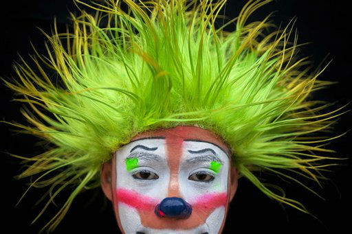 Fiestin poses for a picture on the last day of the fourth annual Latin American Clown Congress in Guatemala City, Thursday, July 26, 2012. Clowns from Central America and South America and the Caribbean have gathered for three days in the capital city to exchange ideas and attend workshops.&#40;AP Photo&#47;Rodrigo Abd&#41; <span class=meta>(AP Photo&#47; Rodrigo Abd)</span>