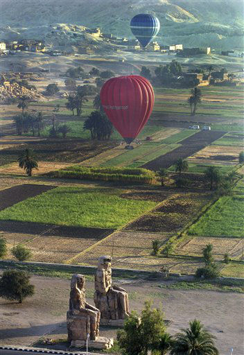 "<div class=""meta ""><span class=""caption-text "">FILE - In this Wednesday, May 24, 2006 file photo, tourists take a hot air balloon tour over Luxor, Egypt. A hot air balloon flying over Egypt's ancient city of Luxor caught fire and crashed into a sugar cane field outside al-Dhabaa village, just west of the city of Luxor,  Egypt, Tuesday, Feb. 26, 2013, killing at least 19 foreign tourists, a security official said. (AP Photo/Mohammed Anan, File) (AP Photo/ Mohammed Anan)</span></div>"