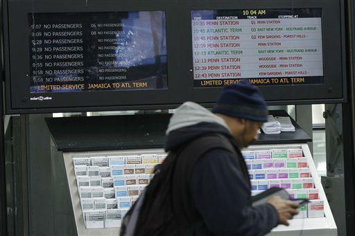A commuter walks past monitors showing limited service at the Long Island Rail Road Jamaica Station Thursday, Nov. 1, 2012, in the New York City borough of Queens. Three days after superstorm Sandy made landfall, residents and commuters still faced obstacles as they tried to return to pre-storm routines. &#40;AP Photo&#47;Frank Franklin II&#41; <span class=meta>(AP Photo&#47; Frank Franklin II)</span>
