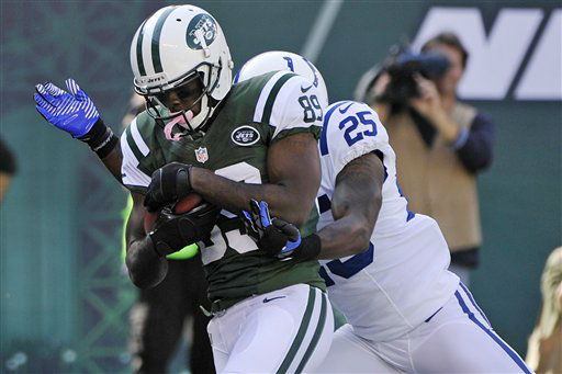 New York Jets wide receiver Jason Hill &#40;89&#41; catches a pass in front of Indianapolis Colts cornerback Jerraud Powers &#40;25&#41; during the first half of an NFL football game Sunday, Oct. 14, 2012 in East Rutherford, N.J. &#40;AP Photo&#47;Bill Kostroun&#41; <span class=meta>(AP Photo&#47; Bill Kostroun)</span>