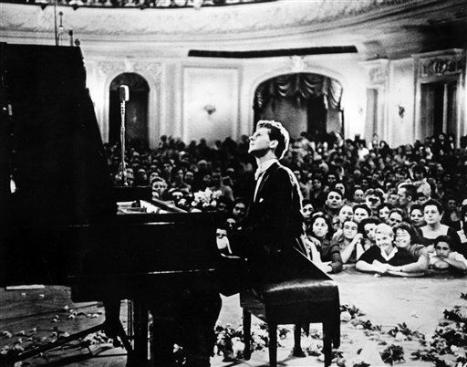In this photo provided by the Van Cliburn Foundation, Texas pianist Van Cliburn performs to a packed audience in the Great Hall of the Moscow Conservatory in Moscow, Russia, in April 1958 during the first International Tchaikovsky Competition, which he won. Cliburn, the internationally celebrated pianist whose triumph at a 1958 Moscow competition helped thaw the Cold War and launched a spectacular career that made him the rare classical musician to enjoy rock star status died early Wednesday, Feb. 27, 2013, at his Fort Worth home following a battle with bone cancer. He was 78.  &#40;AP Photo&#47;Courtesy of Van Cliburn Foundation, file&#41; <span class=meta>(AP Photo&#47; Anonymous)</span>