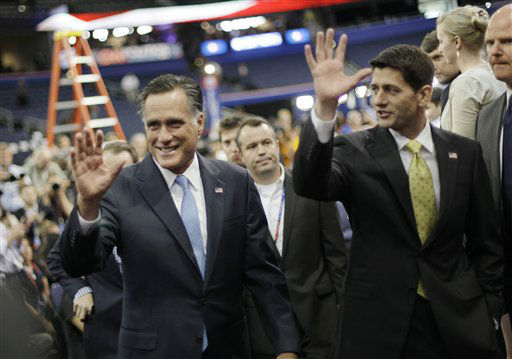 Republican presidential nominee Mitt Romney and his vice presidential running mate Rep. Paul Ryan, R-Wis. wave to their supporters after posing a group picture with their campaign staff at the Republican National Convention in Tampa, Fla., on Thursday, Aug. 30, 2012.  &#40;AP Photo&#47;David Goldman&#41; <span class=meta>(AP Photo&#47; David Goldman)</span>