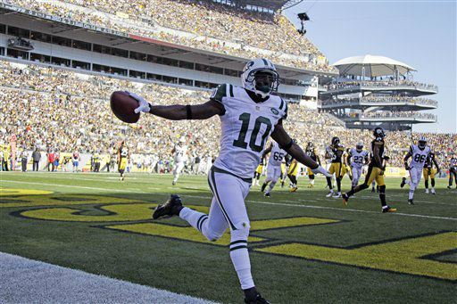 New York Jets wide receiver Santonio Holmes &#40;10&#41; celebrates after making a touchdown catch of an NFL football game against the Pittsburgh Steelers in Pittsburgh, Sunday, Sept. 16, 2012. &#40;AP Photo&#47;Gene J. Puskar&#41; <span class=meta>(AP Photo&#47; Gene J. Puskar)</span>