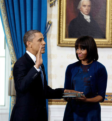 "<div class=""meta ""><span class=""caption-text "">President Barack Obama is officially sworn-in by Chief Justice John Roberts, not pictured, in the Blue Room of the White House Sunday, Jan. 20, 2013, in Washington, as first lady Michelle Obama holds the Robinson Family Bible. (AP Photo/Doug Mills, The New York Times, Pool) (AP Photo/ Doug Mills)</span></div>"