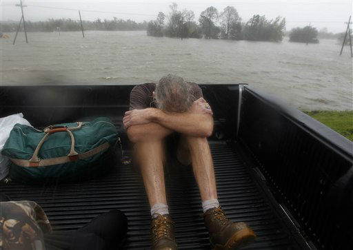 Residents who were rescued from their flooded homes are transported to waiting assistance, after Hurricane Isaac made landfall and flooded homes with 10 feet of water in Braithwaite, La., Wednesday, Aug. 29, 2012. Isaac was packing 80 mph winds, making it a Category 1 hurricane. It came ashore early Tuesday near the mouth of the Mississippi River, driving a wall of water nearly 11 feet high inland and soaking a neck of land that stretches into the Gulf.  &#40;AP Photo&#47;Gerald Herbert&#41; <span class=meta>(AP Photo&#47; Gerald Herbert)</span>