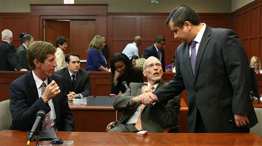 George Zimmerman, right, greets his defense counsel, Mark O&#39;Mara, left, and Don West, as they arrive in court to hear a jury question, on the 25th day of Zimmerman&#39;s trial at the Seminole County Criminal Justice Center in Sanford, Fla., Saturday, July 13, 2013. Zimmerman has been charged with second-degree murder the 2012 shooting death of Trayvon Martin. &#40;AP Photo&#47;Joe Burbank, Pool&#41; <span class=meta>(AP Photo&#47; Joe Burbank)</span>