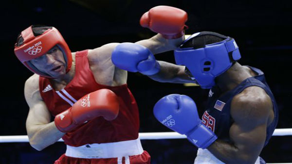 USA&#39;s Terrell Gausha fights Armenia&#39;s Andranik Hakobyan, left, during a middle weight 75-kg preliminary boxing match at the 2012 Summer Olympics, Saturday, July 28, 2012, in London. &#40;AP Photo&#47;Patrick Semansky&#41; <span class=meta>(AP Photo&#47; Patrick Semansky)</span>