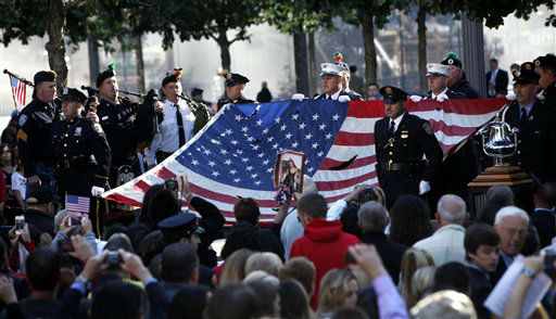 The World Trade Center Flag is presented as friends and relatives of the victims of the Sept. 11 terrorist attacks on the World Trade Center attend a ceremony marking the 11th anniversary of the attacks at the National September 11 Memorial at the World Trade Center site in New York, Tuesday, Sept. 11, 2012. &#40;AP Photo&#47;Jason DeCrow&#41; <span class=meta>(AP Photo&#47; Jason DeCrow)</span>