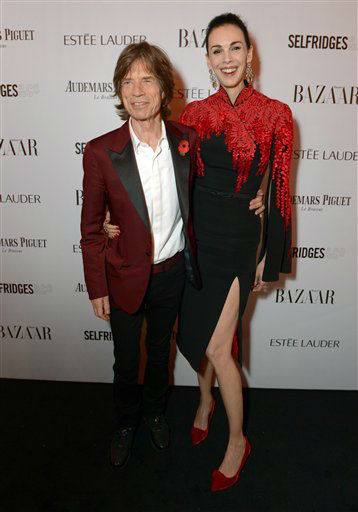 IMAGE DISTRIBUTED FOR HARPE'S BAZAAR - Sir Mick Jagger and girlfriend designer L'Wren Scott attend Harper's Bazaar Women of the Year Awards 2013 at Claridge's Hotel on Tuesday, Nov. 5, 2013, in London. (Photo by Jon Furniss/Invision for Harper's Bazaar/AP)