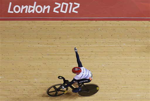 Britain&#39;s Jason Kenny celebrates after clinching the gold medal in the track cycling men&#39;s sprint event, during the 2012 Summer Olympics in London, Monday, Aug. 6, 2012. &#40;AP Photo&#47;Matt Rourke&#41; <span class=meta>(AP Photo&#47; Matt Rourke)</span>