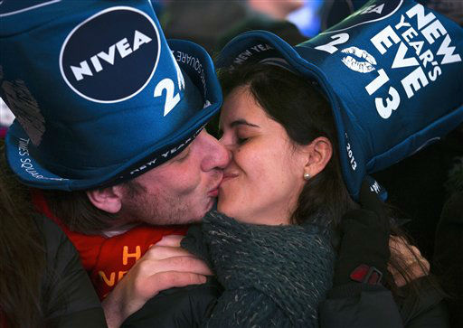 Simone Renes and Cristina Vanoli, of Italy, share a kiss in Times Square at the New Year&#39;s Eve celebration, Monday, Dec. 31, 2012, in New York. &#40;AP Photo&#47;John Minchillo&#41; <span class=meta>(AP Photo&#47; John Minchillo)</span>