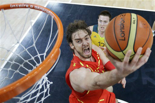 Spain&#39;s Pau Gasol lays up a shot as he breaks past Australia&#39;s Aron Baynes at the 2012 Summer Olympics, Tuesday, July 31, 2012, in London. &#40;AP Photo&#47;Charles Krupa&#41; <span class=meta>(AP Photo&#47; Charles Krupa)</span>