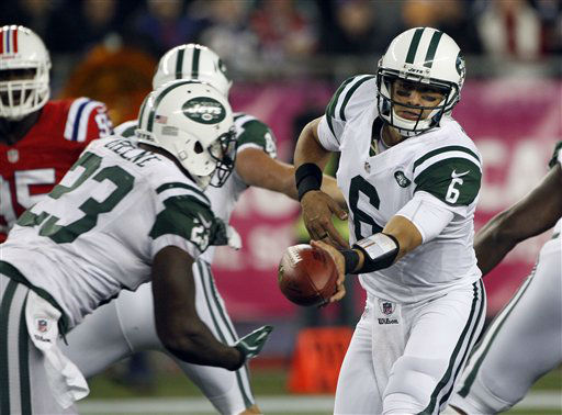 New York Jets quarterback Mark Sanchez &#40;6&#41; hands off to running back Shonn Greene &#40;23&#41; in the third quarter of an NFL football game against the New England Patriots in Foxborough, Mass., Sunday, Oct. 21, 2012. &#40;AP Photo&#47;Stephan Savoia&#41; <span class=meta>(AP Photo&#47; Stephan Savoia)</span>