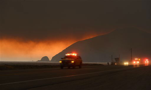 "<div class=""meta image-caption""><div class=""origin-logo origin-image ""><span></span></div><span class=""caption-text"">Fire department personnel drive along Pacific Coast Highway near Point Mugu as a thick layer of smoke sits overhead during a wildfire that burned several thousand acres, Thursday, May 2, 2013, in Ventura County, Calif.   (AP Photo/Mark J. Terrill) (AP Photo/ Mark J. Terrill)</span></div>"