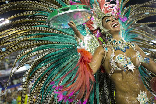 A performer from the Mangueira samba school parades during carnival celebrations at the Sambadrome in Rio de Janeiro, Brazil, Monday, Feb. 11, 2013. &#40;AP Photo&#47;Felipe Dana&#41; <span class=meta>(AP Photo&#47; Felipe Dana)</span>