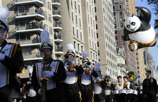 The Kung Fu Panda balloon, right, participates in the 86th annual Macy&#39;s Thanksgiving Day Parade,Thursday, Nov 22, 2012, in New York. &#40;AP Photo&#47; Louis Lanzano&#41; <span class=meta>(AP Photo&#47; Louis Lanzano)</span>
