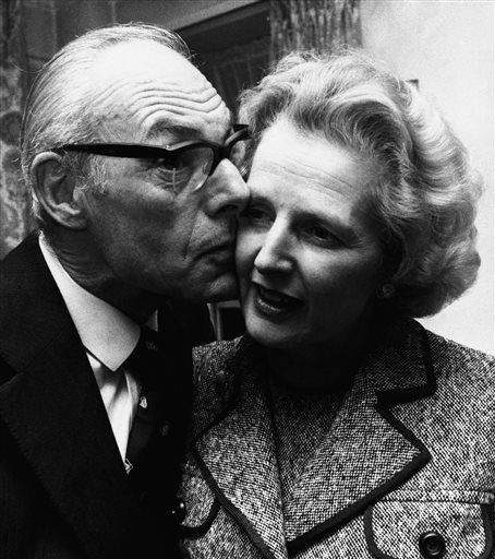 FILE - In a Feb. 4, 1975 file photo, Margaret Thatcher gets a kiss  from her husband Denis in London, Feb. 4, 1975, after she had come out on top with 130 votes in the first round of the election for the Conservative party leadership. Thatchers former spokesman, Tim Bell, said that the former British Prime Minister Margaret Thatcher had died Monday morning, April 8, 2013, of a stroke.  She was 87 years old. &#40;AP Photo&#47;File&#41; <span class=meta>(AP Photo&#47; Uncredited)</span>