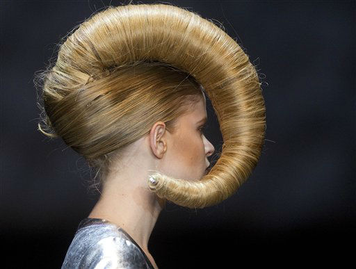 A model displays a creation by hair stylist Julio Crepaldi during the Hair Fashion Show in Sao Paulo, Brazil, Thursday, Aug. 30, 2012. &#40;AP Photo&#47;Andre Penner&#41; <span class=meta>(AP Photo&#47; Andre Penner)</span>