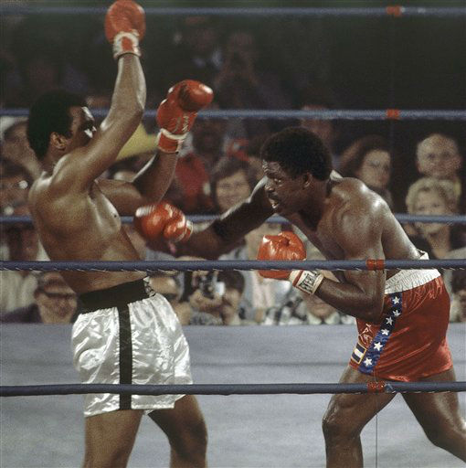 FILE - In this May 16, 1975, file photo, Muhammad Ali, left, battles Ron Lyle, during the 11th round of a heavyweight title bout in Las Vegas. Lyle, who fought Muhammad Ali for the title in 1975 and later battled George Foreman, died Saturday, Nov. 26, 2011, in Denver, a Salvation Army official said. He was 70.  &#40;AP Photo&#47;File&#41; <span class=meta>(AP Photo&#47; RB)</span>