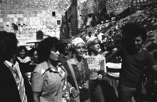 Elizabeth Taylor &#40;r&#41; visits the Wailing Wall in Jerusalem &#40;background&#41; on August 28, 1975 on first day of current visit to Israel.  Because of the orthodox ruling at this holiest of Judaic sites, men and women are separated at wall and Richard Burton was at another section. &#40;AP Photo&#47;mAX Nash&#41; <span class=meta>(AP Photo&#47; Max Nash)</span>