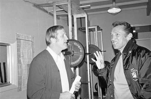 George Blanda, left, 48, in his 26th pro football season, has some conversation with Al Davis managing general partner of the Oakland Raiders, in the team?s training quarter in Oakland, Dec. 12, 1975. Blanda, the oldest player in National Football League history became the league?s all-time high scorer several years ago and should reach the 2,000 point mark on Sunday. &#40;AP Photo&#47;RHH&#41; <span class=meta>(AP Photo&#47; RHH)</span>
