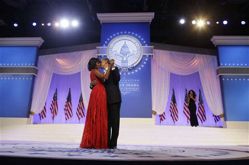 President Barack Obama and first lady Michelle Obama, wearing a ruby colored chiffon and velvet Jason Wu gown, dance as singer Jennifer Hudson, right, sings Al Green&#39;s &#34;Let&#39;s Stay Together&#34; at the Inaugural Ball at the Washington Convention Center during the 57th Presidential Inauguration in Washington, Monday, Jan. 21, 2013. &#40;AP Photo&#47;Charles Dharapak&#41; <span class=meta>(AP Photo&#47; Charles Dharapak)</span>