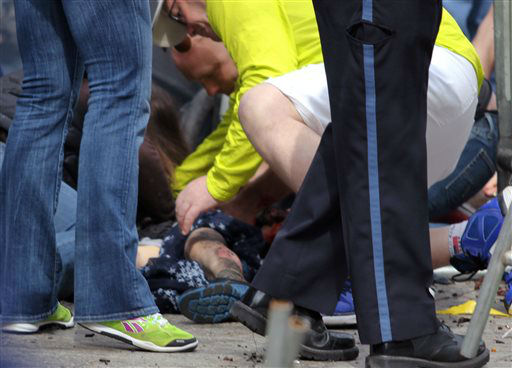 In this photo provided by The Daily Free Press and Kenshin Okubo, people help an injured person after an explosion at the 2013 Boston Marathon in Boston, Monday, April 15, 2013. Two explosions shattered the euphoria of the Boston Marathon finish line on Monday, sending authorities out on the course to carry off the injured while the stragglers were rerouted away from the smoking site of the blasts. &#40;AP Photo&#47;The Daily Free Press, Kenshin Okubo&#41; MANDATORY CREDIT <span class=meta>(AP Photo&#47; Kenshin Okubo)</span>