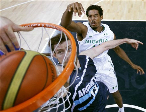 "<div class=""meta ""><span class=""caption-text "">Argentina's Andres Nocioni, left, slams a dunk as he gets past Nigeria's Alade Aminu during a men's basketball game at the 2012 Summer Olympics, Saturday, Aug. 4, 2012, in London. (AP Photo/Charles Krupa) (AP Photo/ Charles Krupa)</span></div>"
