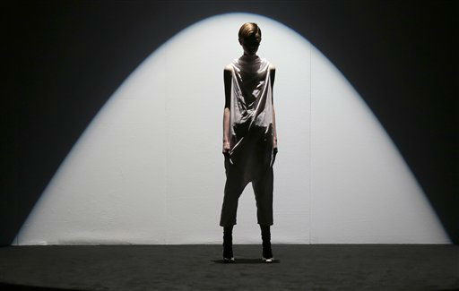 "<div class=""meta ""><span class=""caption-text "">A model wears the fashions of designer Zambesi during their show at Fashion Week in Sydney, Australia, Friday, April 12, 2013. (AP Photo/Rick Rycroft) (AP Photo/ Rick Rycroft)</span></div>"
