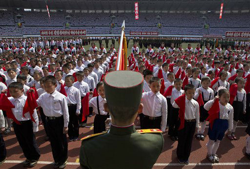 "<div class=""meta ""><span class=""caption-text "">North Korean children hold up red scarves to be tied around their necks during an induction ceremony into the Korean Children's Union, the first political organization for North Koreans, held at a stadium in Pyongyang on Friday, April 12, 2013. (AP Photo/David Guttenfelder) (AP Photo/ David Guttenfelder)</span></div>"