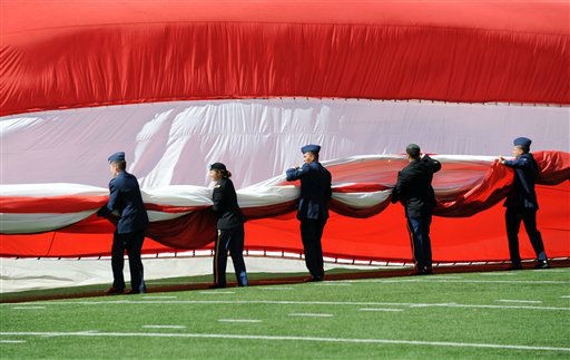 Members of the military gather up an American flag before an NFL football game between the New York Jets and the Buffalo Bills at MetLife Stadium Sunday, Sept. 9, 2012, in East Rutherford, N.J. &#40;AP Photo&#47;Bill Kostroun&#41; <span class=meta>(AP Photo&#47; Bill Kostroun)</span>