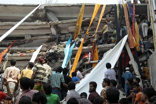 Rescue workers use clothes to bring down survivors and bodies after an eight-story building housing several garment factories collapsed in Savar, near Dhaka, Bangladesh, Wednesday, April 24, 2013. Dozens were killed and many more are feared trapped in the rubble. &#40;AP Photo&#47; A.M. Ahad&#41; <span class=meta>(AP Photo&#47; A.M. Ahad)</span>