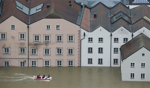 Members of the Red Cross make their way by boats in the flooded street in the center of Passau, southern Germany, Monday, June 3, 2013. Raging waters from three rivers have flooded large parts of the southeast German city following days of heavy rainfall in central Europe. A spokesman for the city?s crisis center said Monday that the situation was ?extremely dramatic? and waters are expected to rise further by midday to their level highest in 70 years. &#40;AP Photo&#47;Matthias Schrader&#41; <span class=meta>(AP Photo&#47; Matthias Schrader)</span>