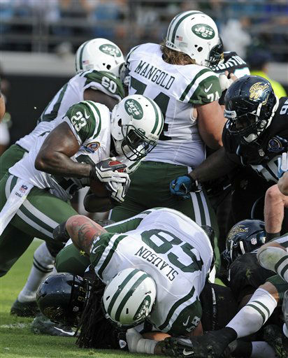 New York Jets running back Shonn Greene &#40;23&#41; runs a 1-yard touchdown past the Jacksonville Jaguars during the second half of an NFL football game, Sunday, Dec. 9, 2012, in Jacksonville, Fla. &#40;AP Photo&#47;Stephen Morton&#41; <span class=meta>(AP Photo&#47; Stephen Morton)</span>
