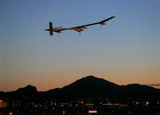 Solar Impulse, piloted by Andr&#233; Borschberg, takes flight during the second leg of the 2013 Across America mission, at dawn, Wednesday, May 22, 2013, from Sky Harbor International Airport in Phoenix. The solar powered aircraft is scheduled to land at Dallas&#47;Fort Worth International Airport on Thursday May 23. The plane&#39;s creators, Bertrand Piccard and Borschberg, said the trip is the first attempt by a solar airplane capable of flying day and night without fuel to fly across America. &#40;AP Photo&#47;Matt York&#41; <span class=meta>(AP Photo&#47; Matt York)</span>