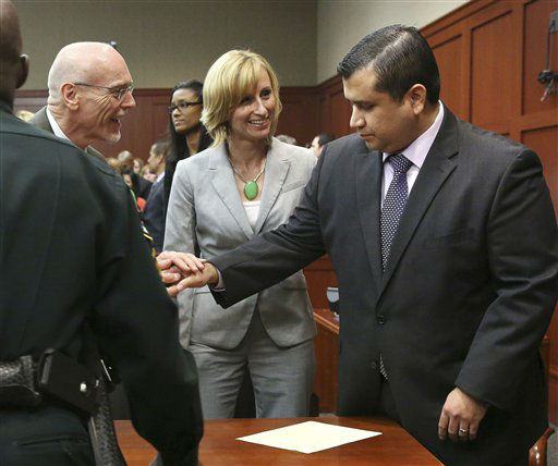 George Zimmerman, right, is congratulated by his defense team after being found not guilty during  Zimmerman&#39;s trial in Seminole circuit court in Sanford, Fla. on Saturday, July 13, 2013. Jurors found Zimmerman not guilty of second-degree murder in the fatal shooting of 17-year-old Martin in Sanford, Fla. The six-member, all-woman jury deliberated for more than 15 hours over two days before reaching their decision Saturday night. &#40;AP Photo&#47;Gary W. Green, Pool&#41; <span class=meta>(AP Photo&#47; Gary W. Green)</span>